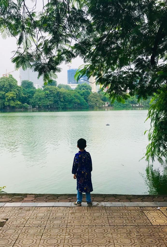 Boy in Kimono looks out at Hoan Kiem Lake