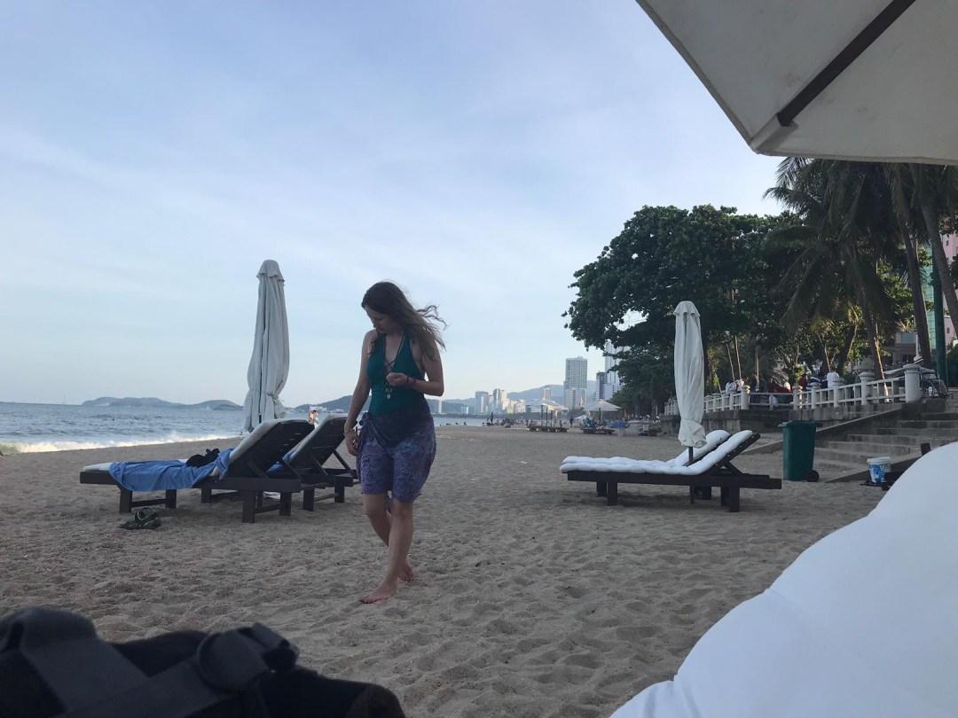 Girl walks along Tran Phu Beach in Nha Trang Vietnam
