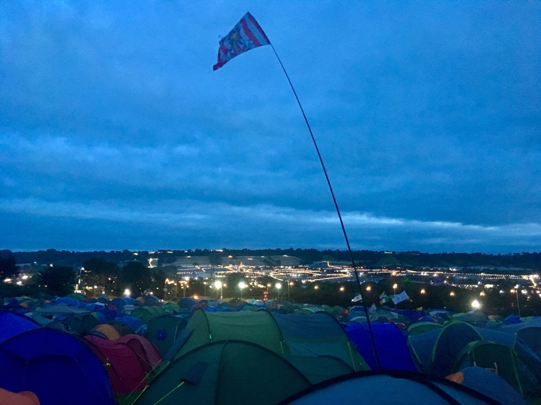 Tents and flag in one of Glastonbury Festival's camping areas