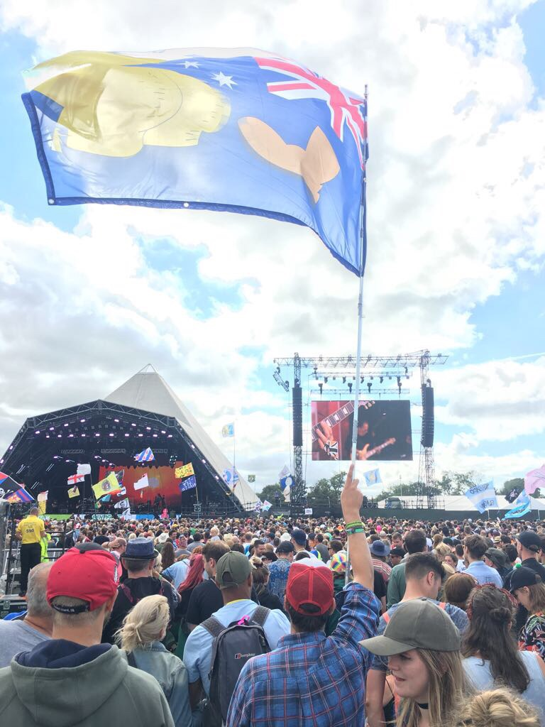 A festival goer waves a flag at the Pyramid stage at Glastonbury Festival 2017