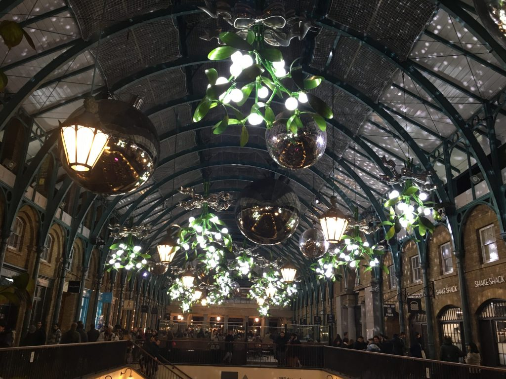 Covent Garden Christmas decorations featuring giant silver baubles and mistletoe