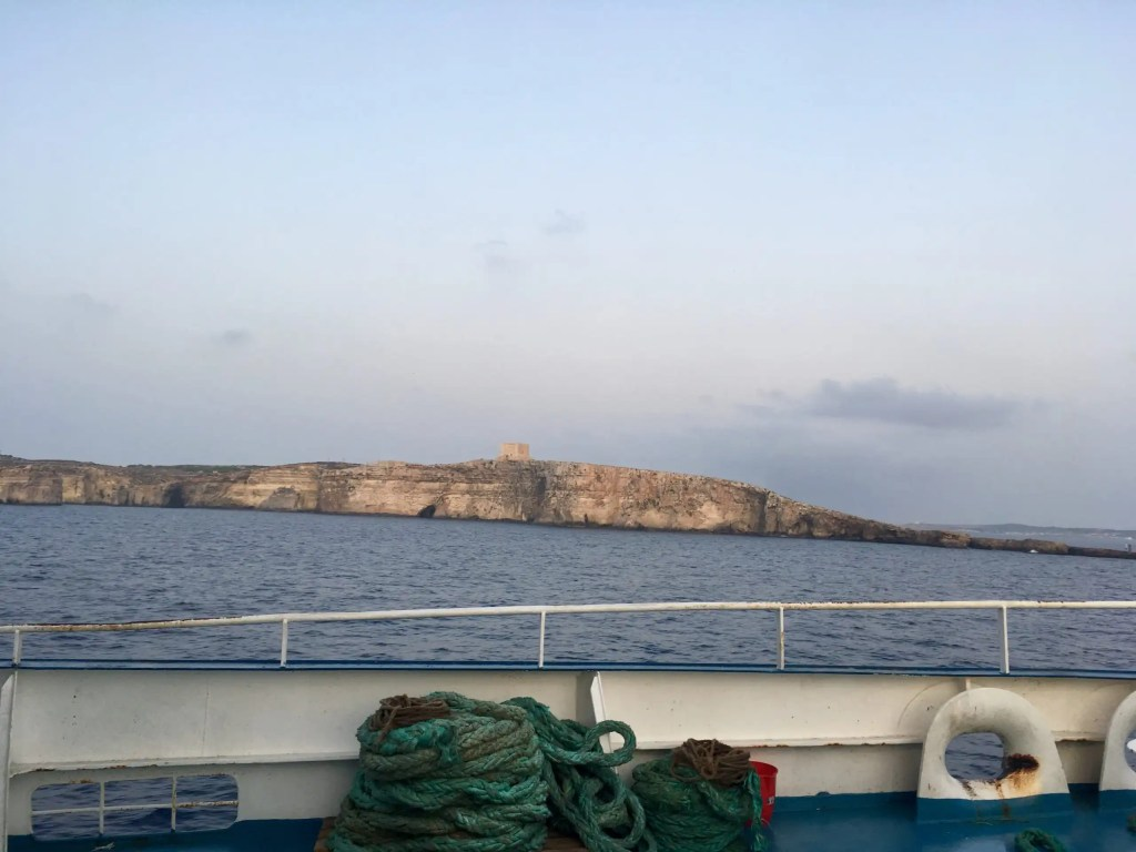 Comino as seen from the ferry from Malta to Gozo - guide to getting around Malta