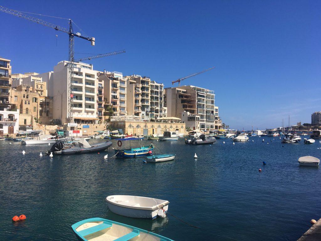 Fishing boats sit in St Julian's bay