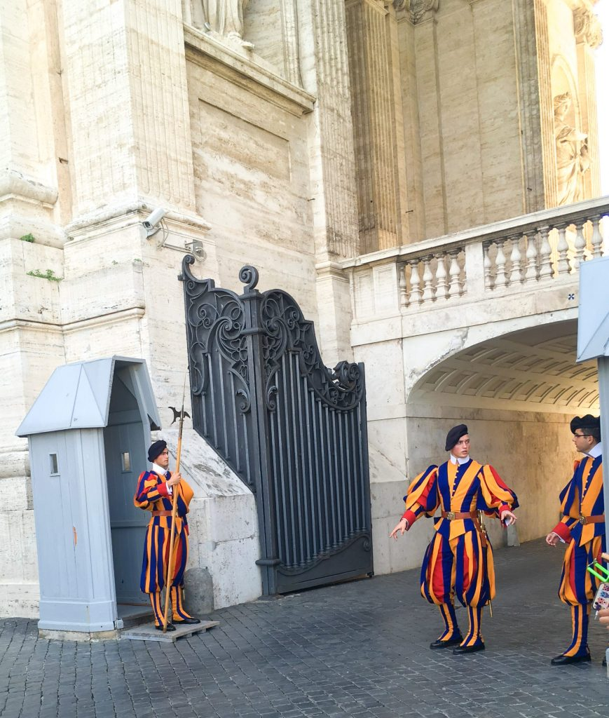 Tourist watch changing of Swiss Guard while visiting Vatican City