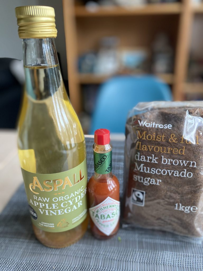 ingredients for eastern North Carolina bbq sauce - apple cyder vinegar, tabasco sauce and dark brown sugar