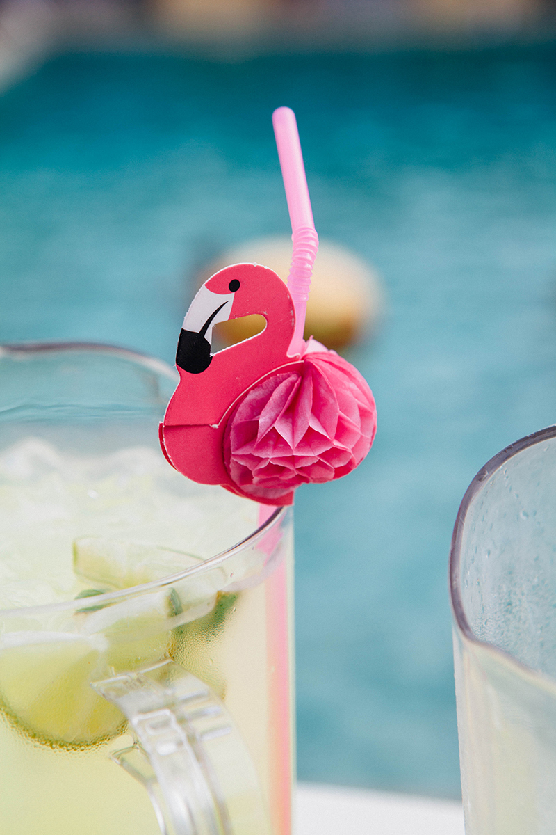 Flamingo-themed pool party wedding as seen on @offbeatbride