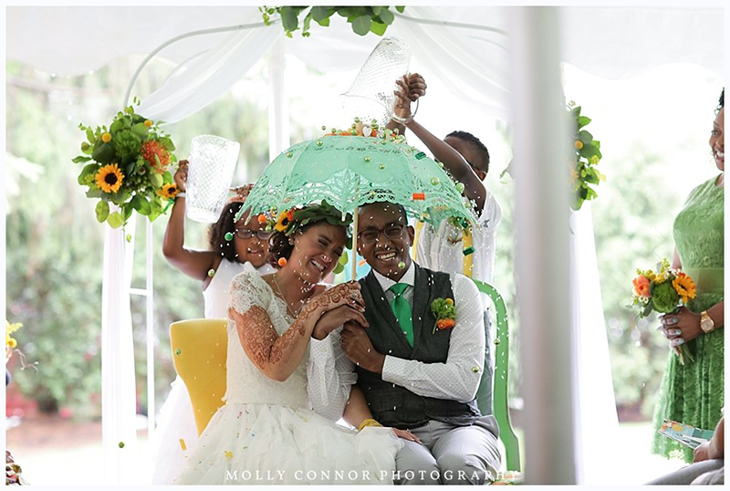 """Rain falls like love at this """"mutual weirdness"""" citrus colored wedding"""