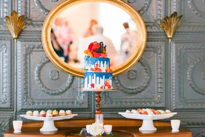 A colorful cake, four wedding pups, & lookalike piñatas at this Dallas Texas wedding