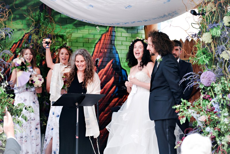 Don't miss the floral dresses, colorful art, and live band at this adorable Colorado wedding