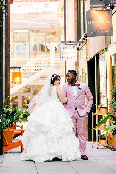 You'll need to fan yourself from the pink suit & striped dress at this romantic brunch wedding