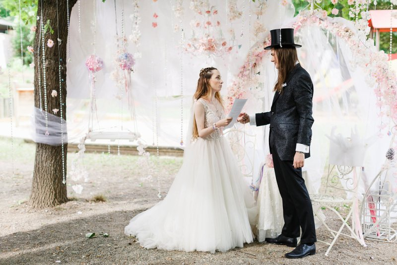 A fairy tale genderfluid cherry blossom vow renewal with a dress-to-suit swap(!)