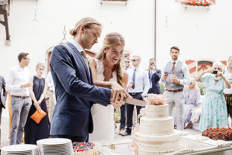 These world travelers tied the knot at their German castle wedding
