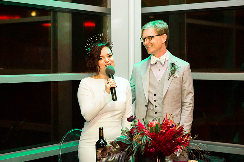 Crowns, pink flowers, & the cosmos at this Space Center wedding