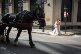 Two beautiful brides stopping for photos on the city streets of Boston