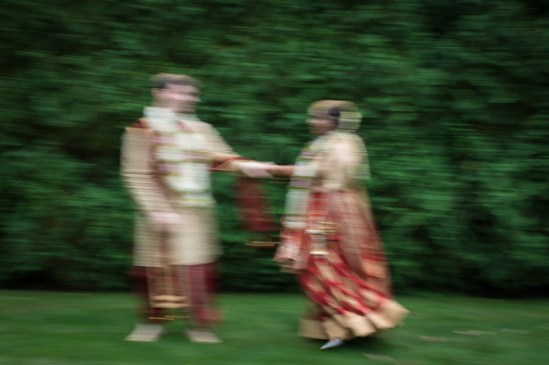 A couple dancing in the grass with a slow shutter photo