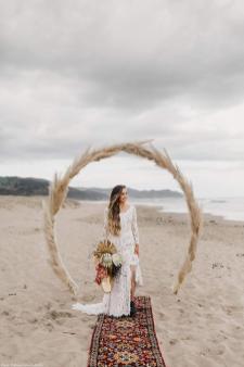 PolinaIvanova long sleeve wedding dress on offbeat bride
