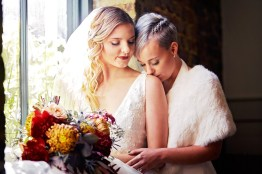 3-luxebylindsay-two-brides-snuggle-shoulder-kiss