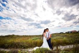 4-luxebylindsay-beach-bride-groom-hold-hands