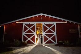 5-luxebylindsay-bride-groom-silhouette-kiss-outside-barn