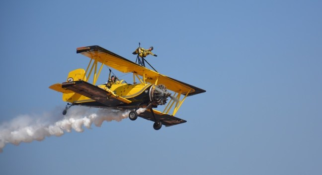 Flying Cats of Scandinavian Airshow Team performing on top the bi-planes at Aero India Show, Bangalore Air Show 2017, Aero Show 2017, Indian Air show