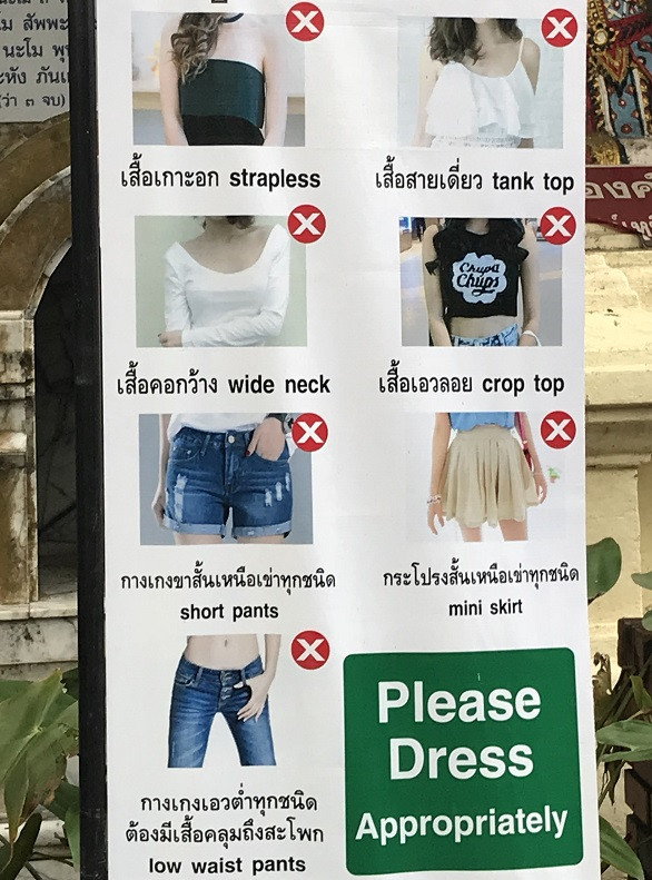 Dress code for entry to Wat Phra That Doi Suthep and other Thailand temples (Wat Phra That Doi Suthep Temple): In general, for all Thailand temples, you need to keep your shoulders arms and legs covered. This image will give you a glimpse of the dress code for Wat Phra That Doi Suthep and also other temples in Thailand. For more details, you may read our post here - http://offbeatexplorers.com/wat-chedi-luang-chiang-mais-stupa/