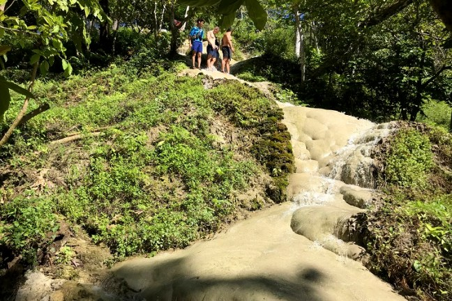 Bua Thong Waterfalls (น้ำตกบัวทอง) in Chiang Mai (Thailand), also known as Sticky Waterfalls is certainly the best of Chiang Mai Waterfalls and one of the top places to visit in Chiang Mai. With limestone deposits giving you full grip, you can walk through this waterfall situated in SriLanna National Forest making it the most unique waterfall of Thailand or even in the world. Also visit Nam Phu Chet Si nearby.