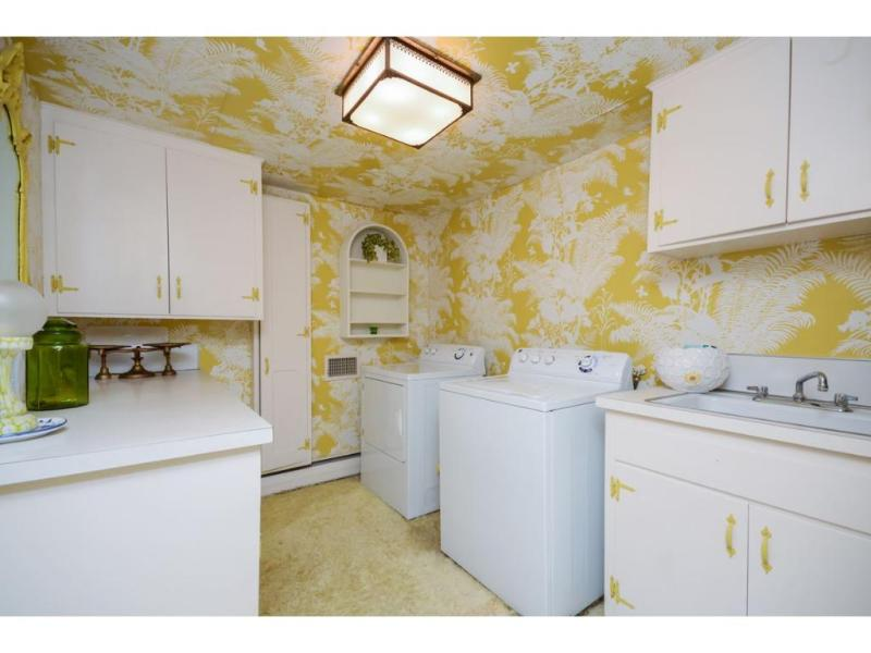 Even the laundry room! LEAVE NO WALL UN-PAPERED!