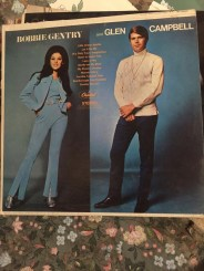 """A bunch of records, including one """"autographed"""" by Glen Campbell. No idea if this is legit."""