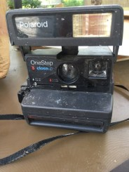A polaroid camera. And not one of those new ironic Polaroids from Urban Outfitters. This is the real deal.