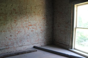 Existing bedroom at the top of the stairs. The plan is for this to become a bathroom & laundry.