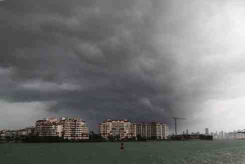 MIAMI BEACH, FL - SEPTEMBER 09: Storm clouds are seen over Fisher Island as Hurricane Irma approaches on September 9, 2017 in Miami Beach, Florida. Florida is in the path of the Hurricane which may come ashore at category 4. (Photo by Joe Raedle/Getty Images)