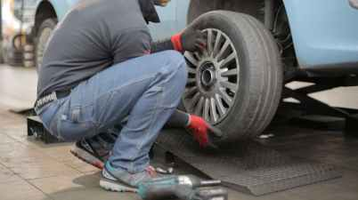 man changing a car tire