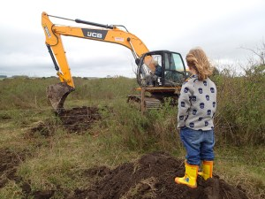Tristan is making sure the excavator guy is doing a proper job