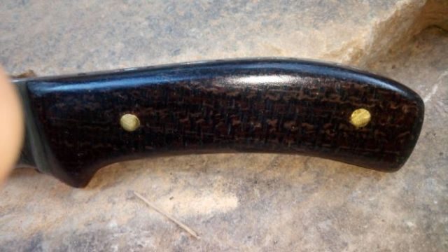 a close up of the micarta knife handle.