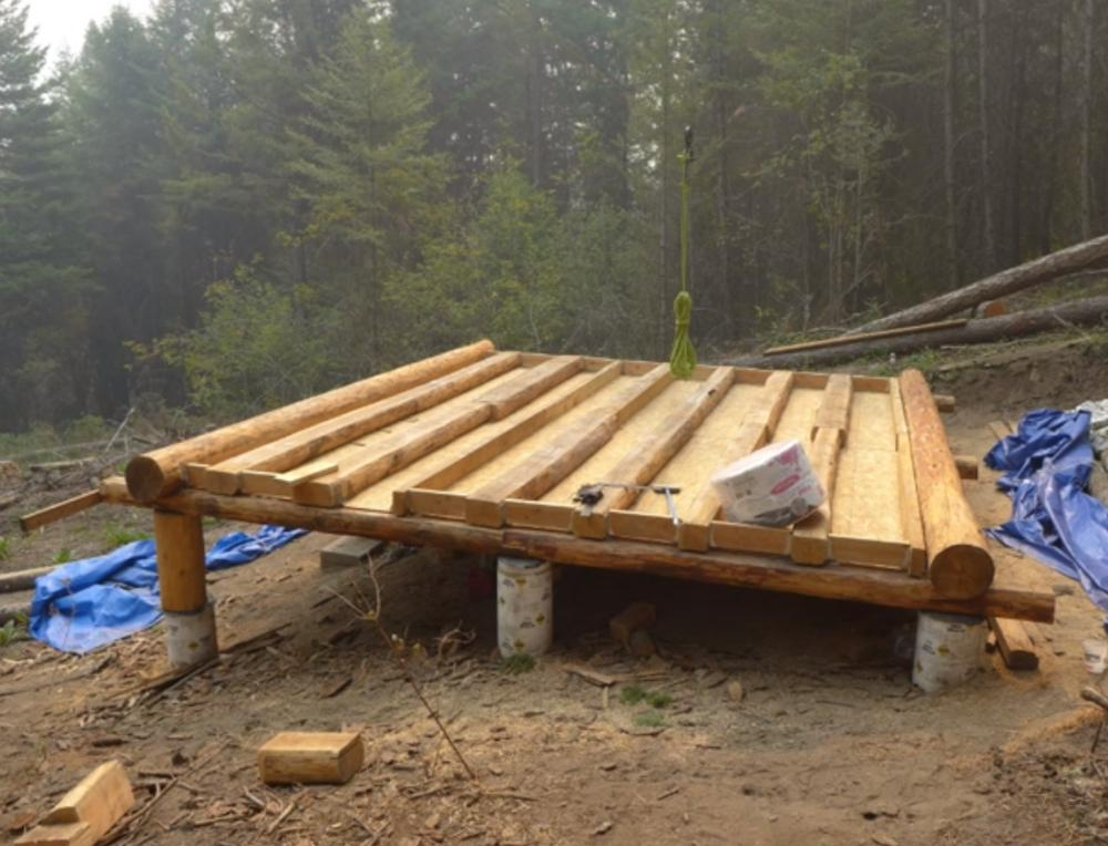 Off grid log cabin build floor construction for How to build a floor for a house