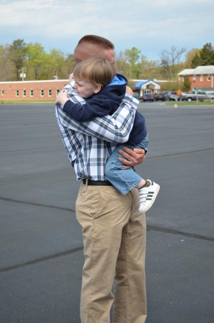 A candidate from OCC-209 greeting his son on Family Day