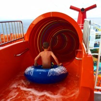 Carnival Cruises Vista cruise ship waterslide red entrance with boy