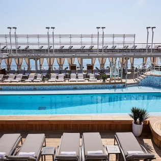 Silversea cruises silver muse cruise ship pool chaise lounges