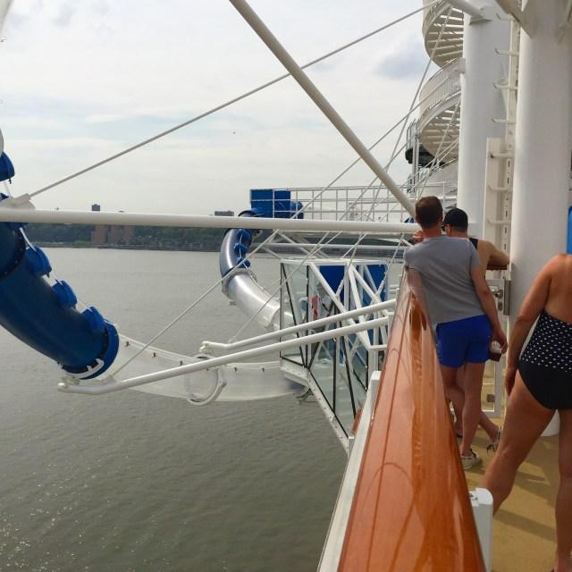 Norwegian Bliss Ocean Look hanging over side of cruise ship