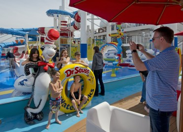 Kids are photographed next to the Cat-in-the-Hat statues at the Dr. Seuss WaterWorks Park onboard the Carnival Horizon. Photo by Andy Newman/Carnival Cruise LinePhoto by Andy Newman/Carnival Cruise Line