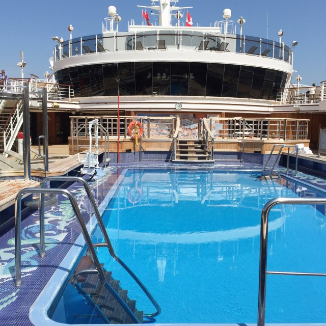 Cunard Queen Elizabeth mid-ship pool cruises from Vancouver to Alaska. Canada bans cruise ships until 2022