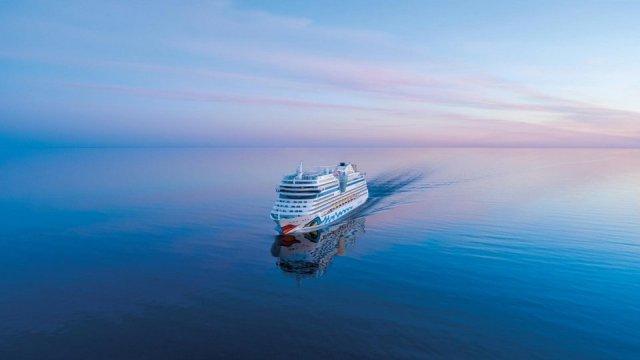 AIDA cruise AIDAcosma cruise ship sunset