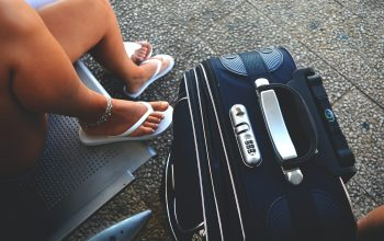 what to pack for a Caribbean cruise blue suitcase white flip flops