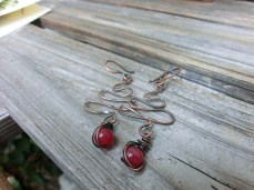 Copper wire with a red stone accent