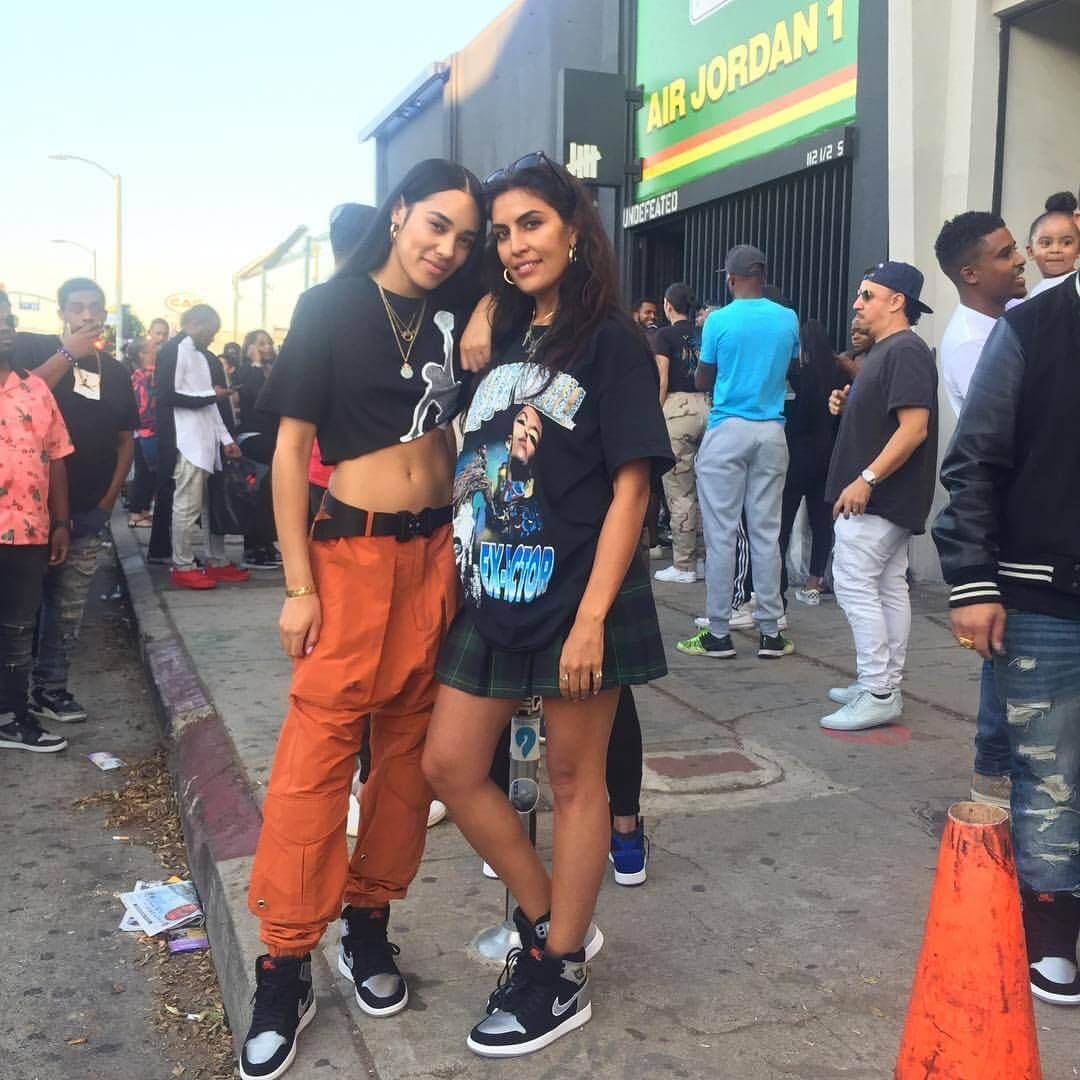 Aleali May and Melody Ehsani wearing. Jordan sneakers