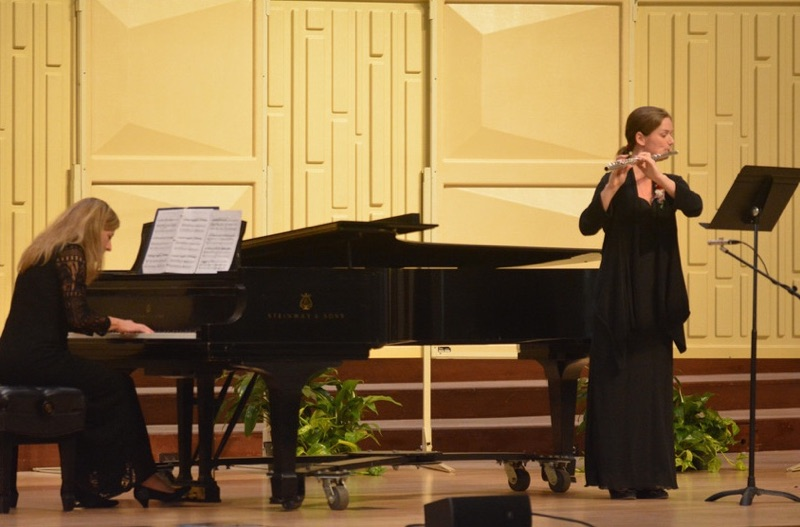 A student plays the flute during the 2018 President's Honor Recital