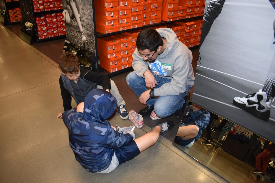 Kids try on shoes at the Nike store
