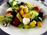 Salad with fresh mozzarella and creamy garlic sauce