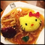 Chicken with fried rice kitty face.