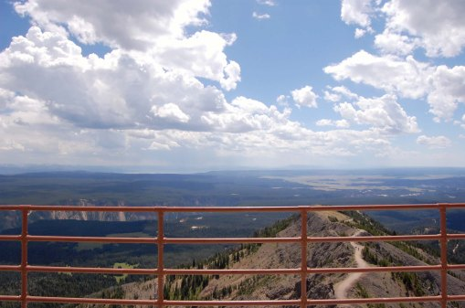 See the Grand Canyon of the Yellowstone, Yellowstone Lake, Mt. Sheridan, and the Grand Tetons (not visible with the storm haze)